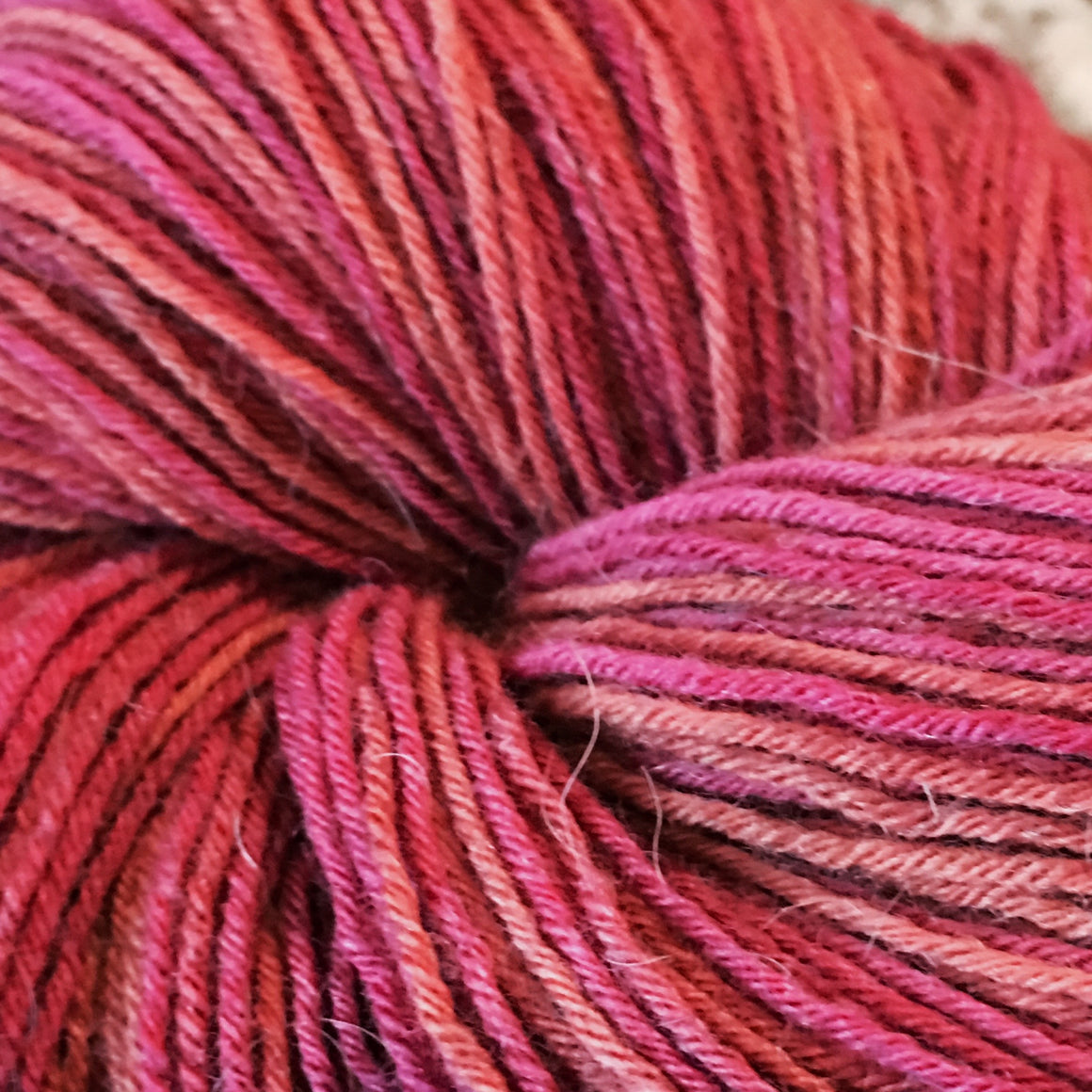 """Flaming Posey"" pink tones in a fingering weight bison blend yarn"