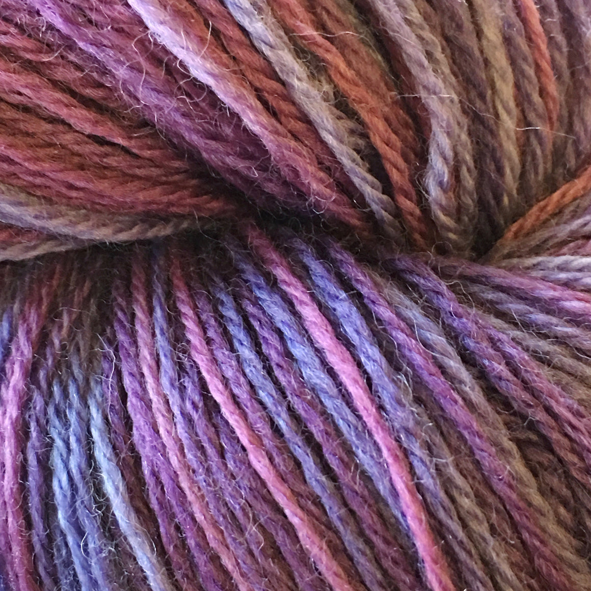 """Pit of Despair"" is full of purple multi tones in a fingering weight super wash merino yarn"