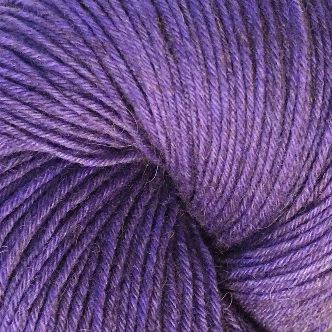 """Bringing up Baby"" is a purple tonal bison blend fingering weight yarn"