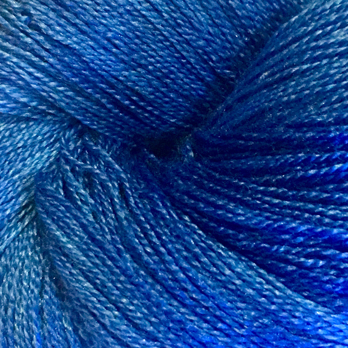 """Blue Jay"" is a light blue super wash merino and silk lace weight yarn"
