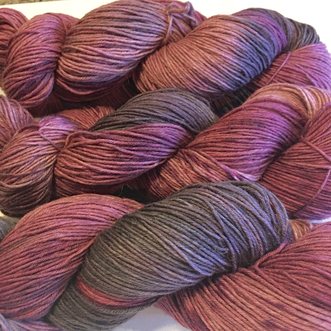 """Briar Rose"" is pink and gray tones in a fingering weight bison yarn"