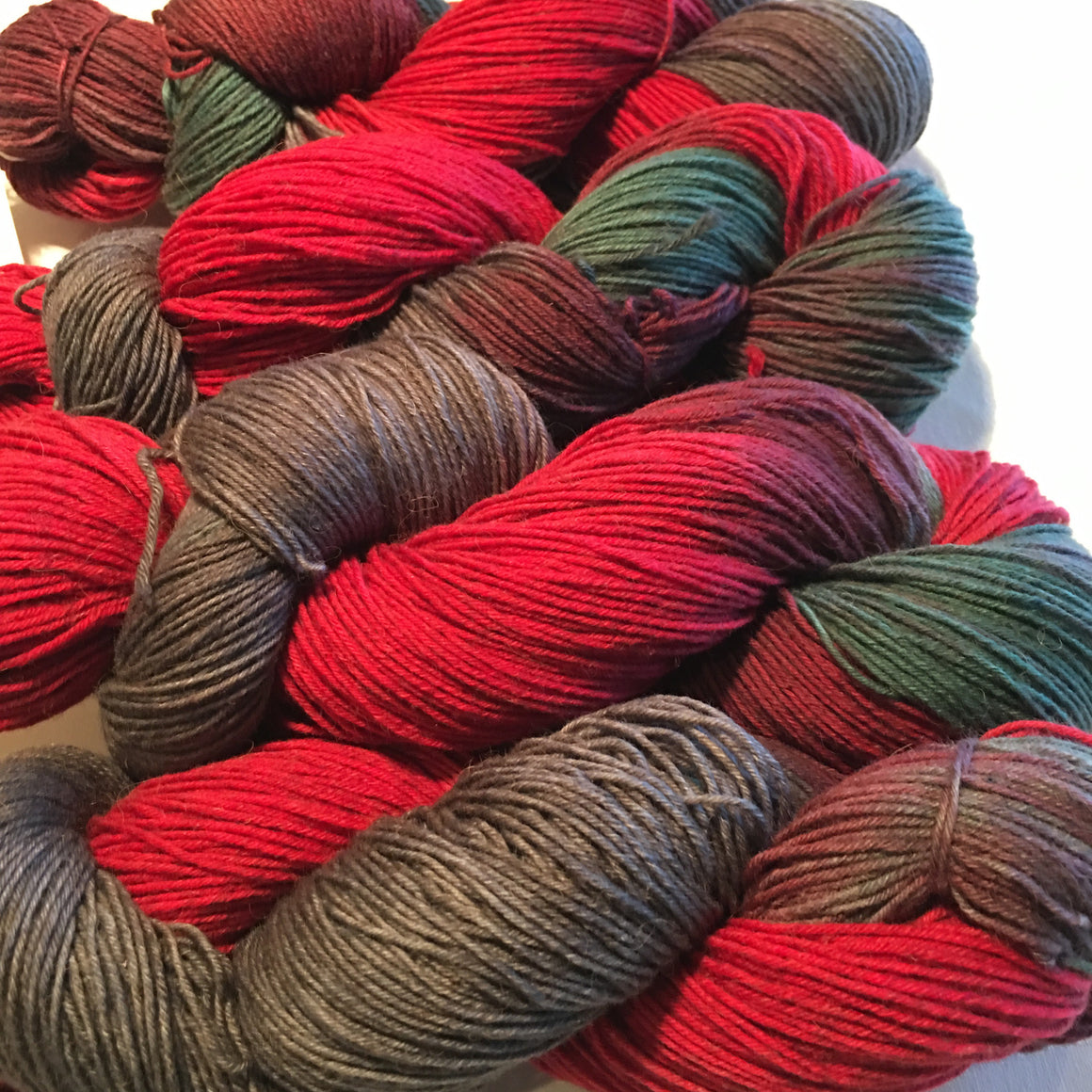 """Firewalkers"" bison yarn is bright red combined with soft grays and earth greens."