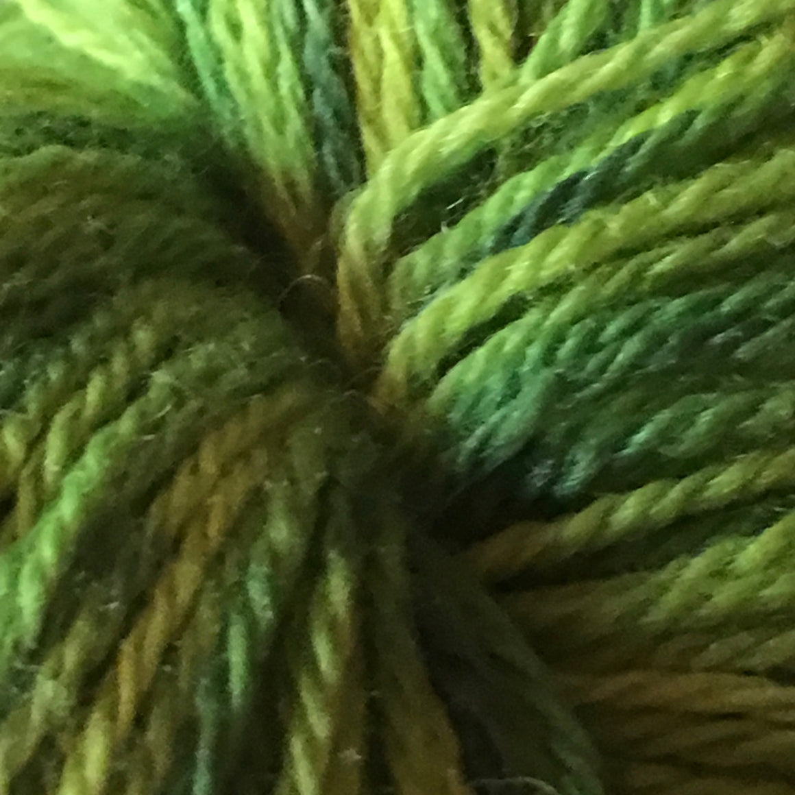"""Dragonscales"" are green tones on a super wash merino fingering weight yarn"