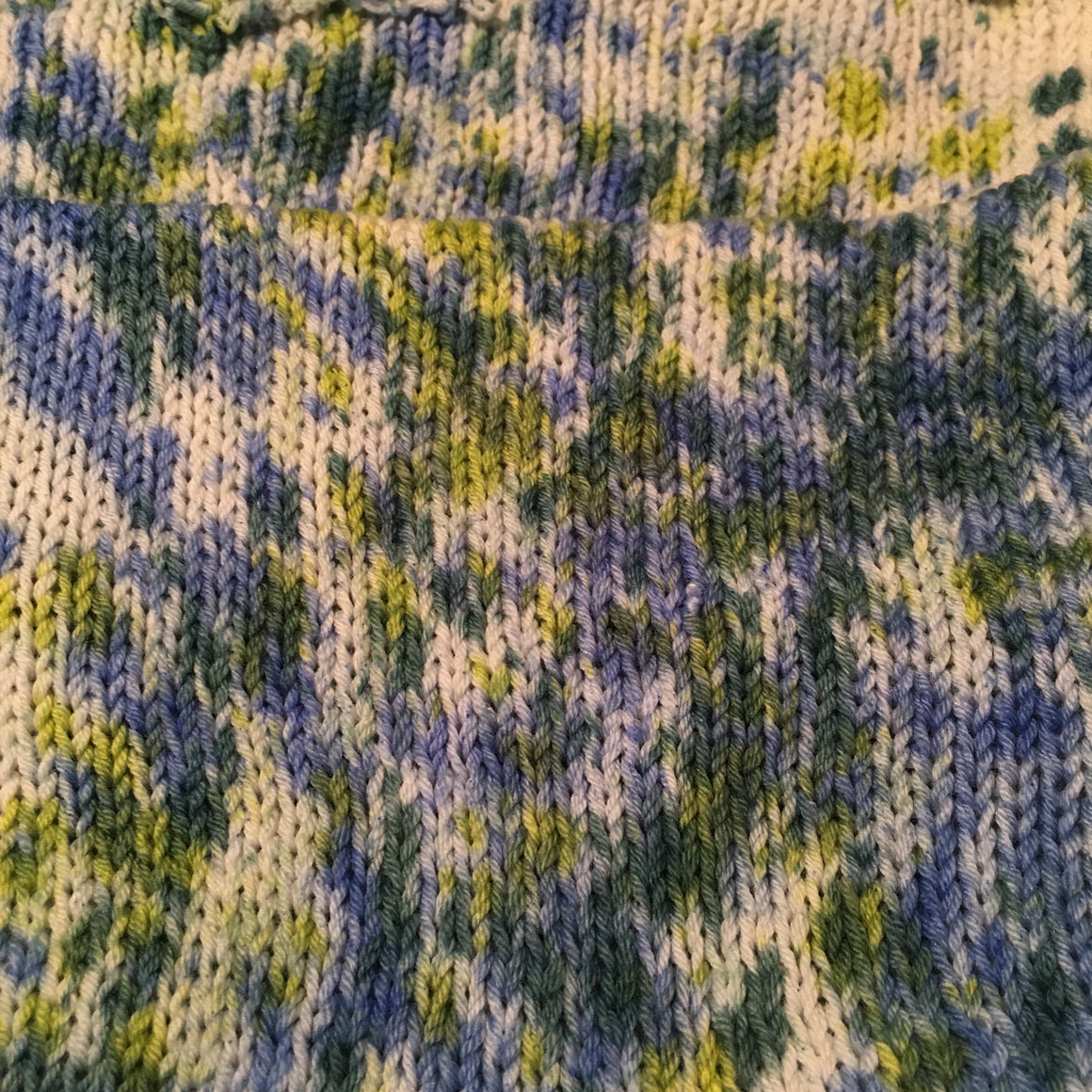 "Doubleknit ""Bluebells"" sock blank with blues and greens on a field of white."