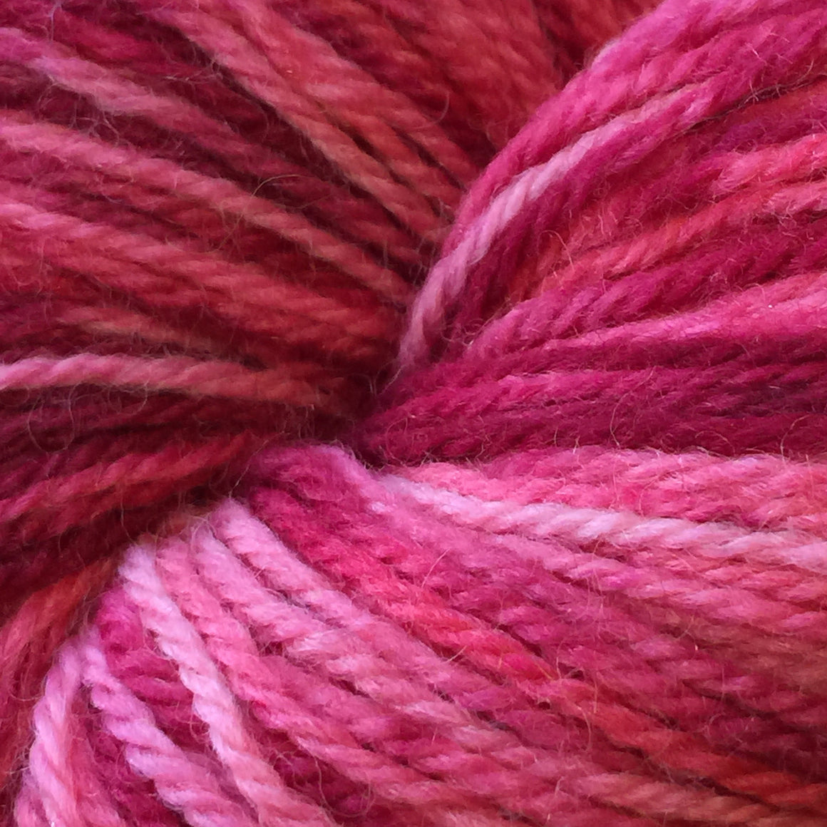 """Casino"" is a pink tonal blend in fingering weight super wash merino yarn"