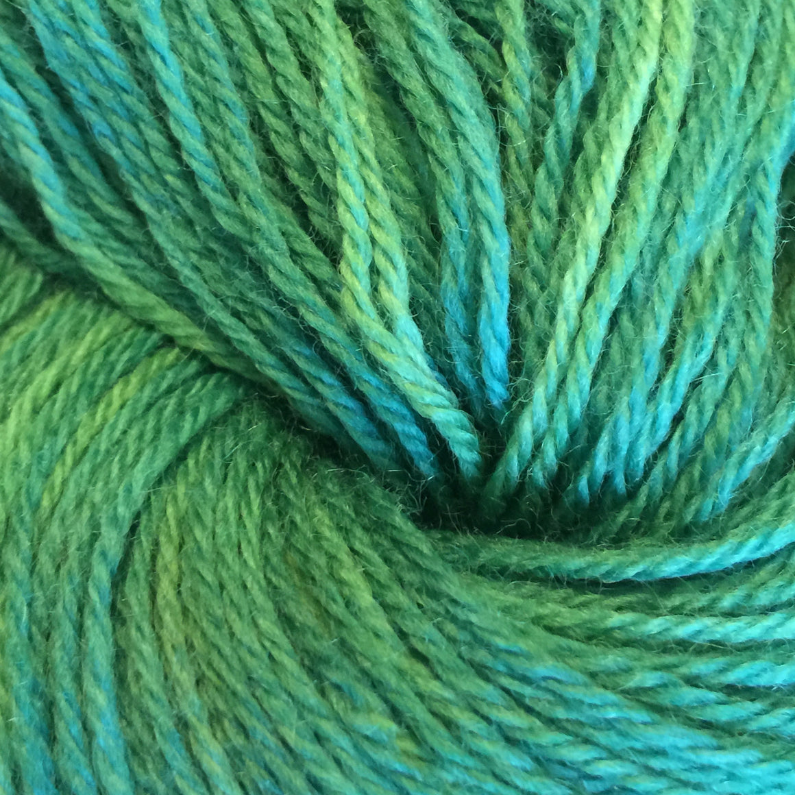 """Greensleeves"" is green tones on a super wash merino fingering weight yarn"