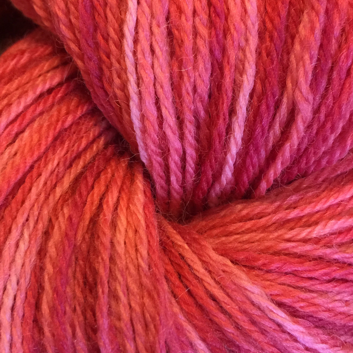 """Funny Girl"" is orange and red tones in a super wash merino fingering weight yarn"