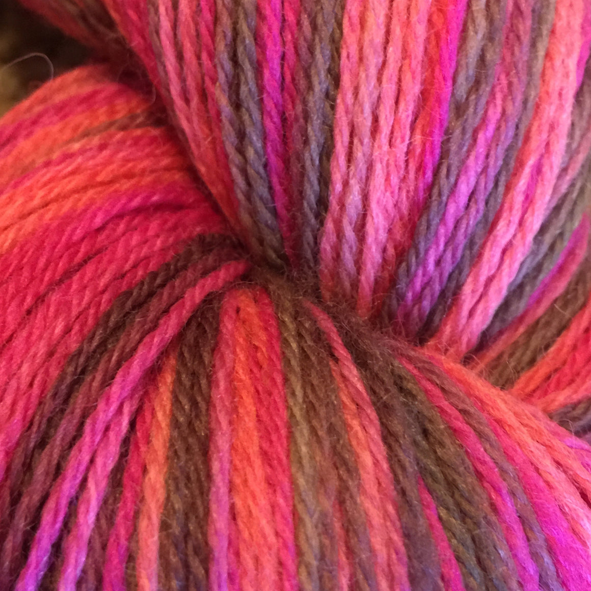 """Strawberry Bomb"" is a splash of pink and strawberry tones in a fingering weight super wash merino yarn"
