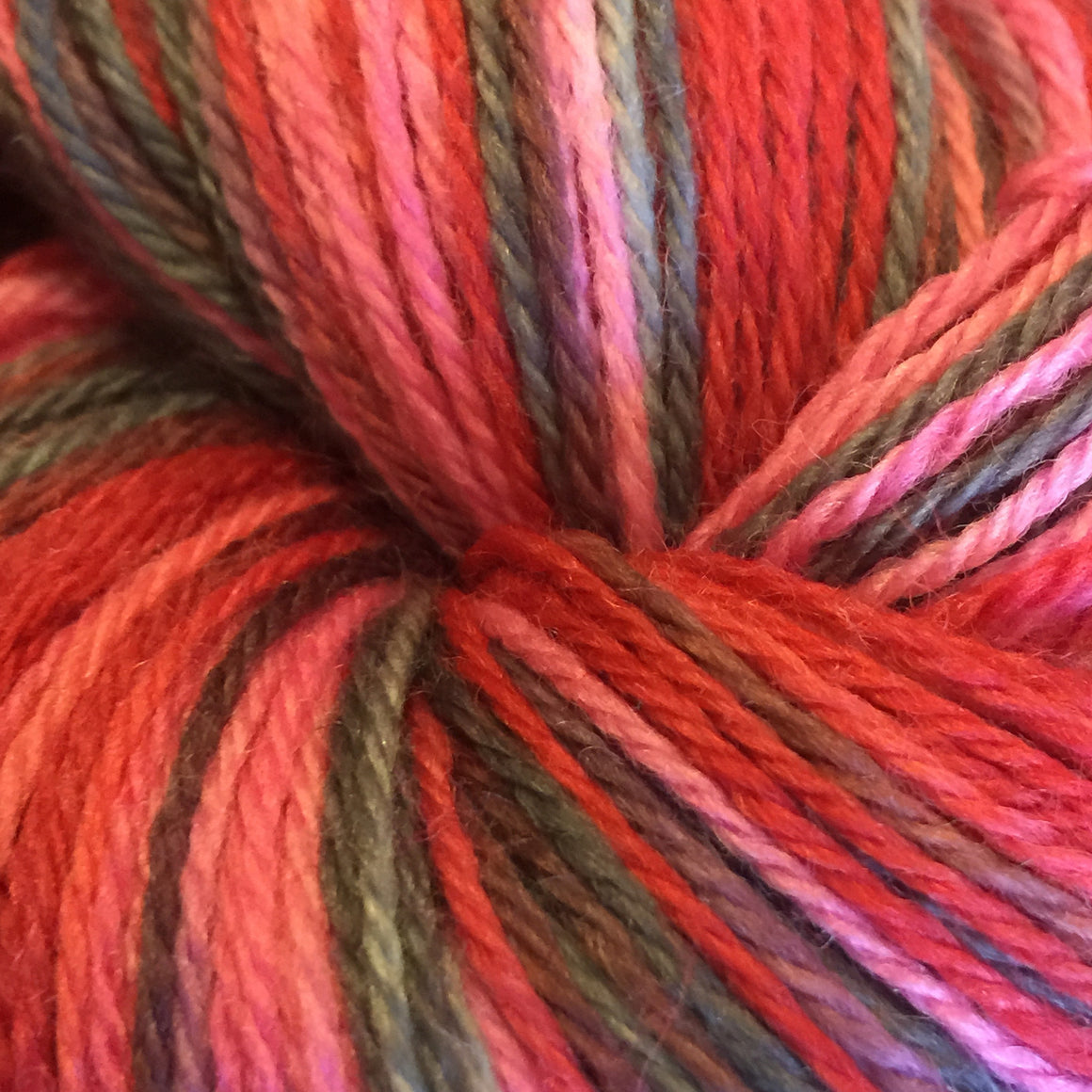 """The Devil Wears Prada"" with red and black tones on a fingering weight super wash merino yarn"
