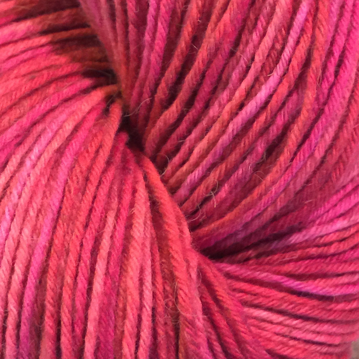 """Electric Angel"" is pink tones blended in a fingering weight bison yarn"