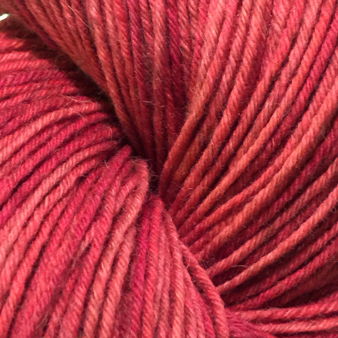 """Afternoon Delight"" are orange blush tones in a bison blend of fingering weight yarn"