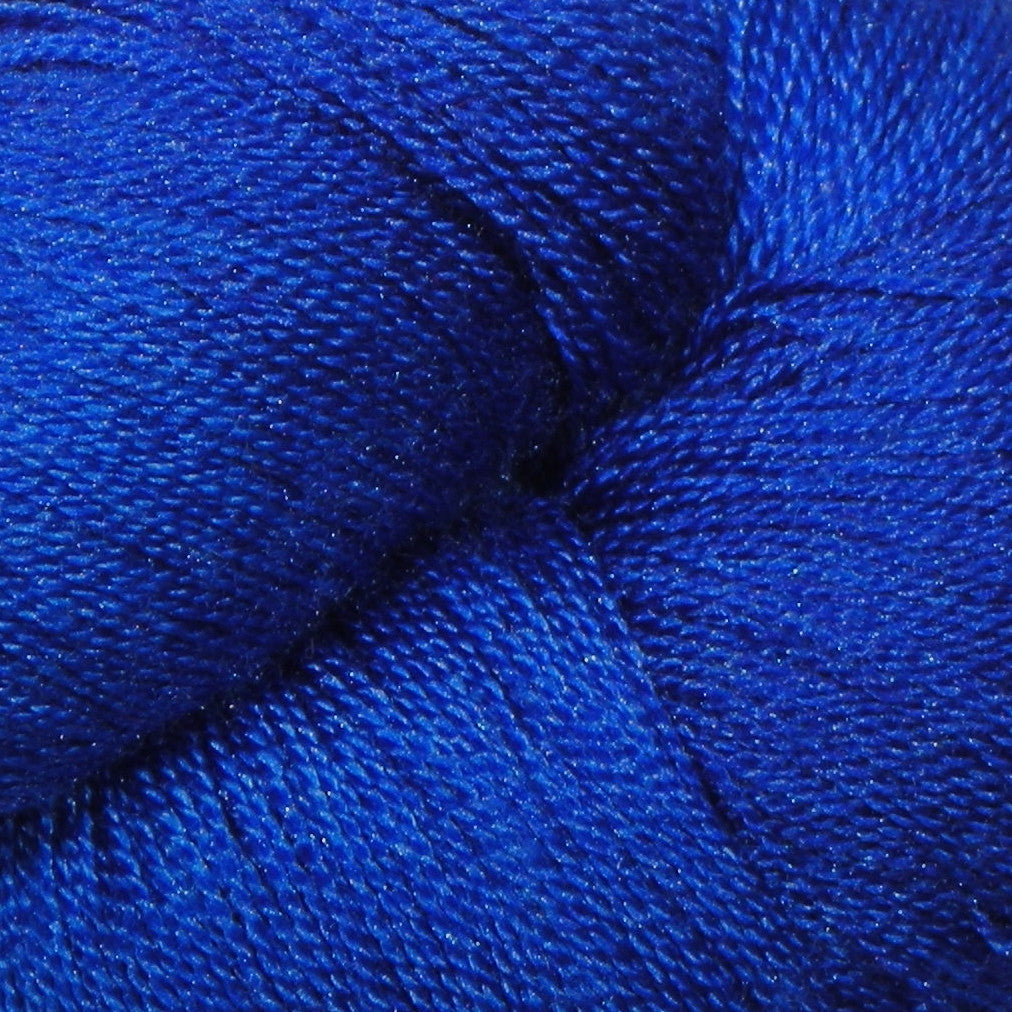 """MockingJay"" is a bright blue color. The bright song of the mockingjay sings in these shimmering folds of color. Knit with this lovely silk/merino hand dyed yarn to hear the beauty."