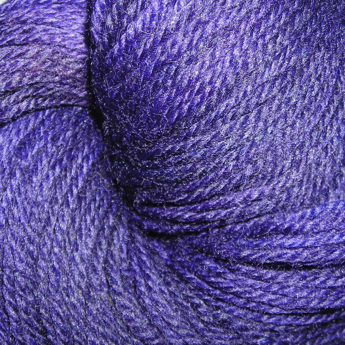 """My Precious"" is a purple toned fingering weight super wash merino weight yarn"