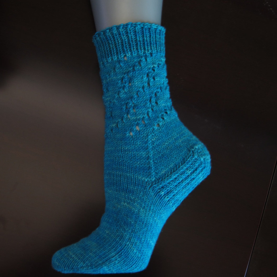 The Ruth's Reversal socks are done with one skein of Knitting Rose Budding Sock yarn. Budding Sock yarn is a superwash wool and bison blend in a fingering weight yarn. These socks are designed by the Knitting Rose, Lise Wilson.