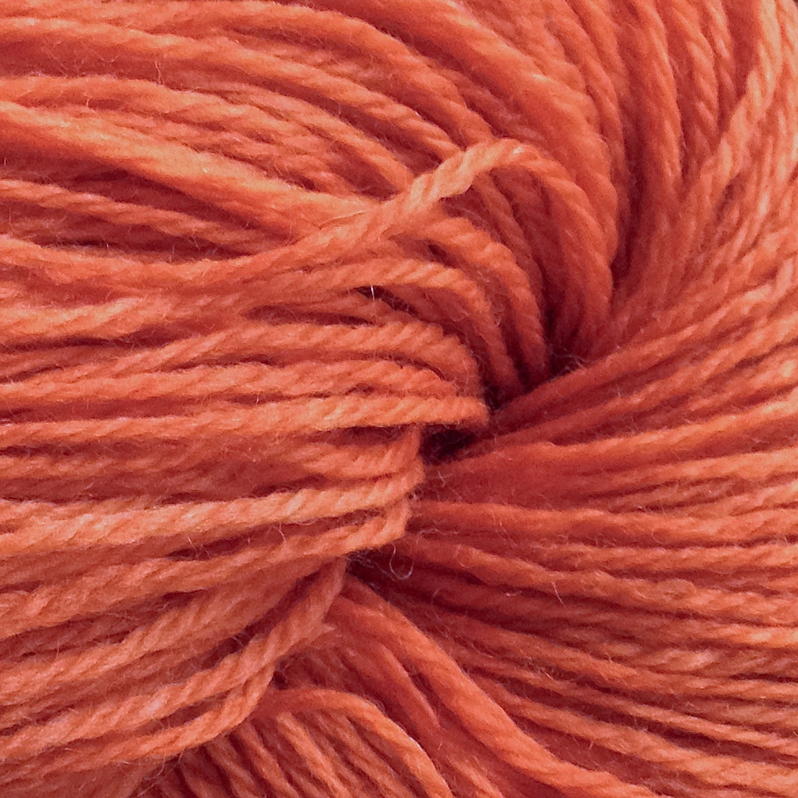 """Stuck on You"" has orange tones sticking to a merino/nylon super wash fingering weight yarn"
