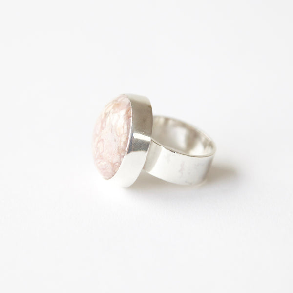 Rhodochrosite gemstone ring in sterling silver - left side with silver band