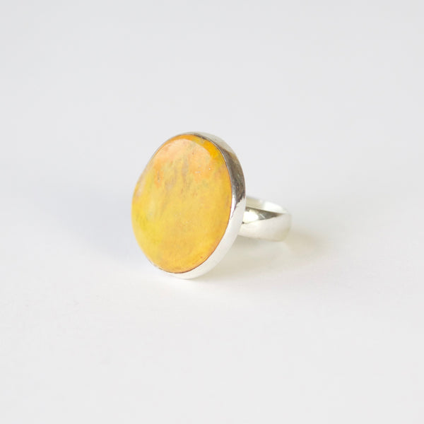 yellow bumble bee jasper in thin silver setting with silver ring - side view