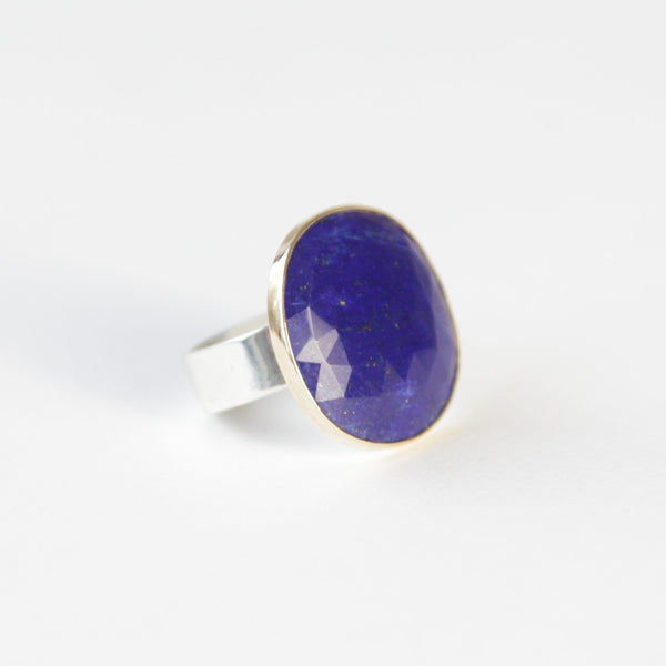 lapis lazuli gemstone ring set in gold with a silver ring - right side