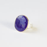 lapis lazuli gemstone ring set in gold with a silver ring
