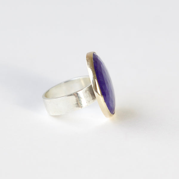 lapis lazuli gemstone ring set in gold with a silver ring - right side with ring