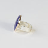 lapis lazuli gemstone ring set in gold with a silver ring - left side with ring
