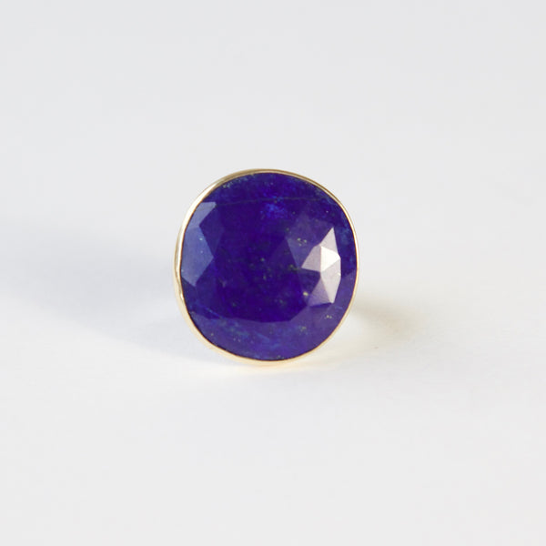 lapis lazuli gemstone ring set in gold with a silver ring - front view of earth stone