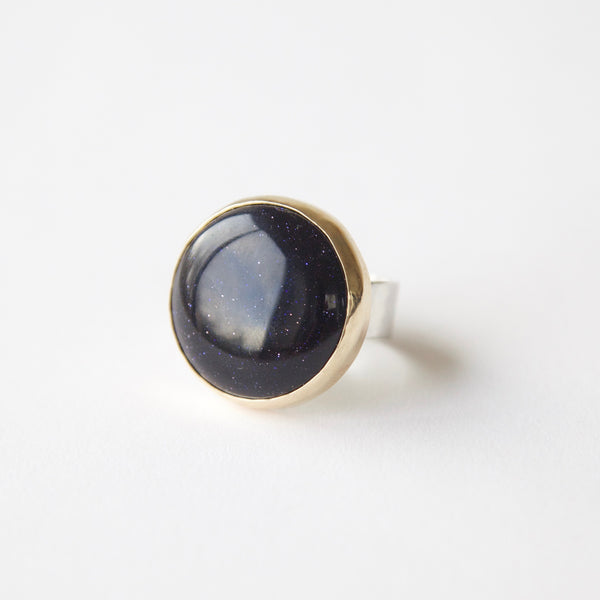 blue goldstone gemstone round ring in 9ct gold - silver band
