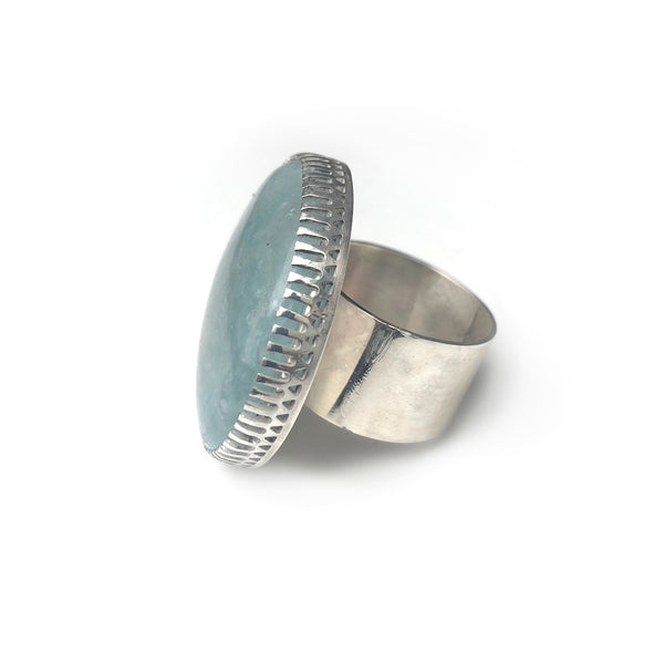 aquamarine gemstone ring in sterling silver - handmade by alice eden - side view of silver band