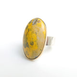 Oval bumblee jasper gemstone ring in gold and silver side view