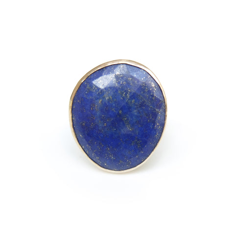 lapis lazuli gemstone ring set in gold with a sterling silver ring