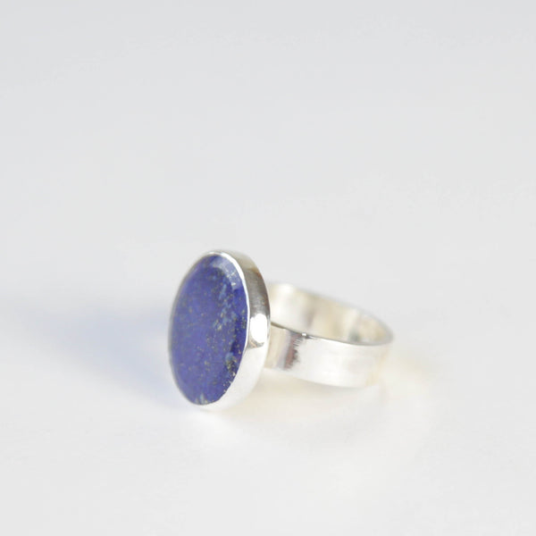 lapis lazuli flat cut gemstone ring set in gold with a sterling silver ring band - from left side