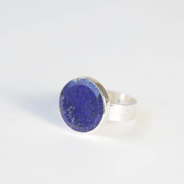 lapis lazuli flat cut gemstone ring set in gold with a sterling silver ring band - front left