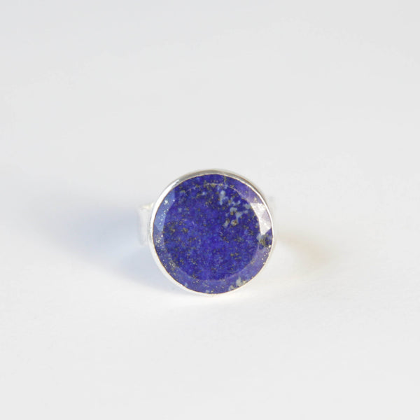 lapis lazuli flat cut gemstone ring set in gold with a sterling silver ring band