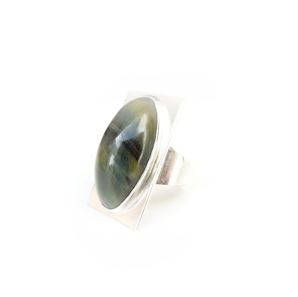 Oval tigers eye gemstone ring set in square sterling silver setting  light