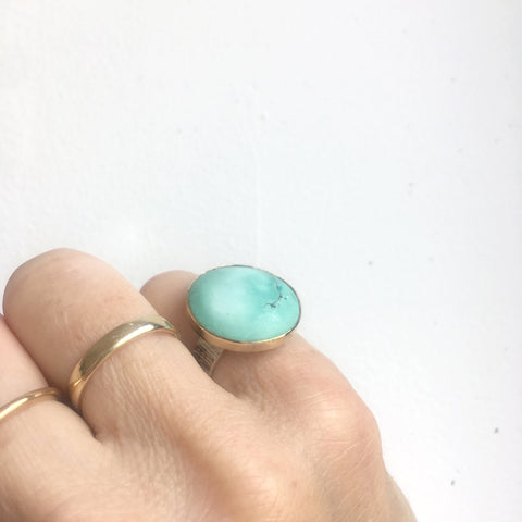 bright tibetan turquoise gemstone ring set in 9ct gold and sterling silver