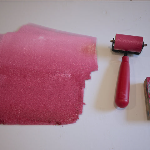 Rolling out the inks with a brayer