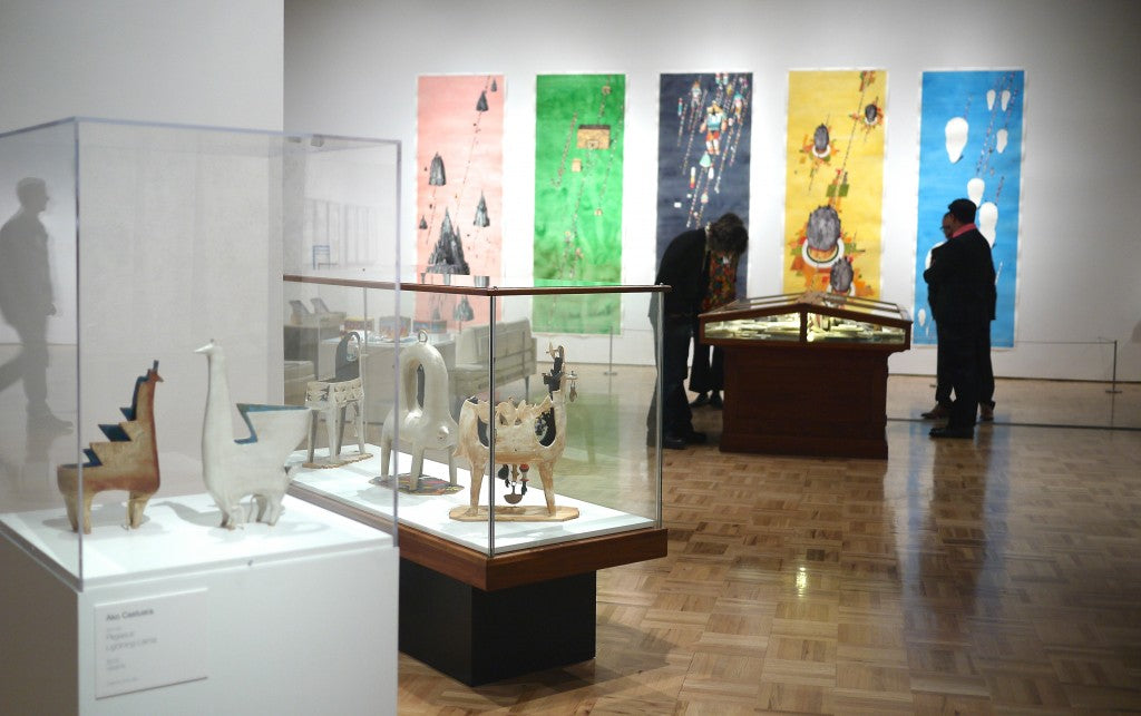 Installation View of Rob Sato paintings and Ako Castuera Sculptures in Super Awesome at Oakland Museum of California