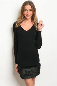 Shop our black dress with fur bottom accent for the holiday season.