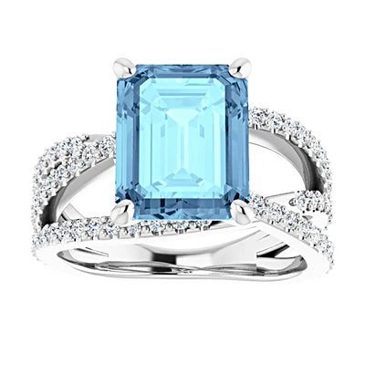 A Swarovski 10K White Gold 4.1CT Emerald Cut Blue Aquamarine Criss Cross Engagement Ring - Joy of London Jewels
