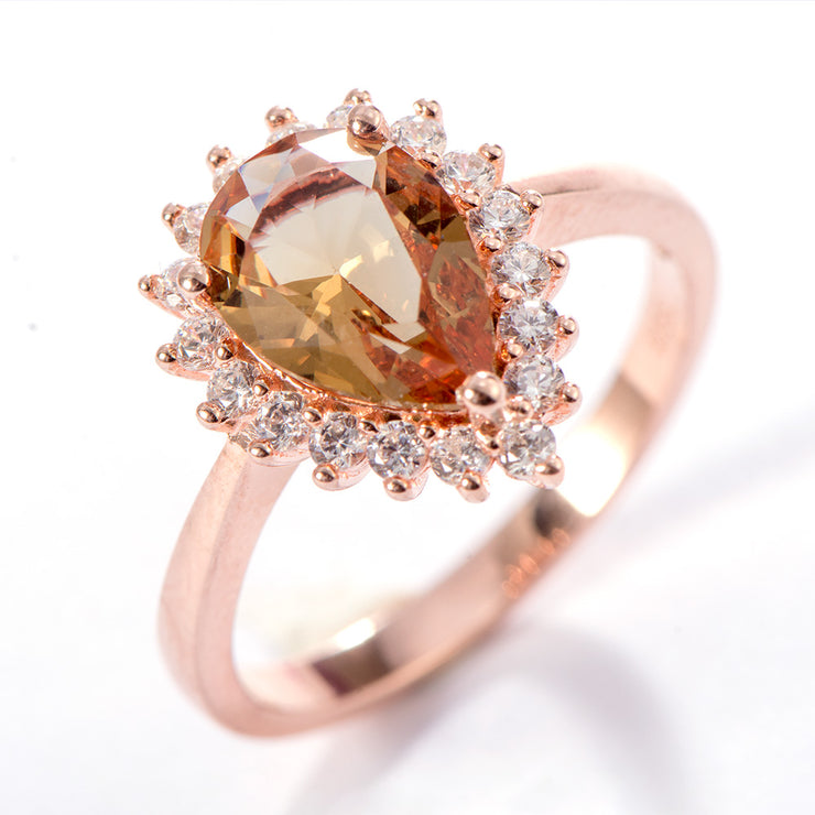A 14K Rose Gold 1.5CT Pear Cut Created Diaspore Halo Engagement Ring (Color Changing) - Joy of London Jewels
