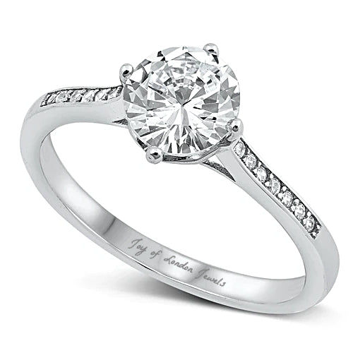A 1.5CT Round Brilliant Cut Engagement Travel Ring