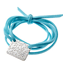the lucky star bracelet on turquoise faux suede