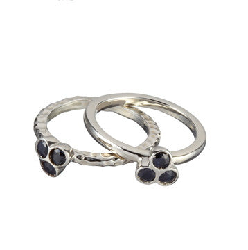 the portafortuna stacking rings in sterling silver with black sapphires
