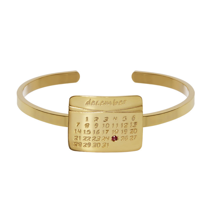 the calendar cuff bracelet<sup>®</sup> in yellow gold