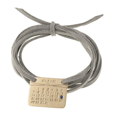 the calendar bracelet<sup>®</sup> in yellow or white gold