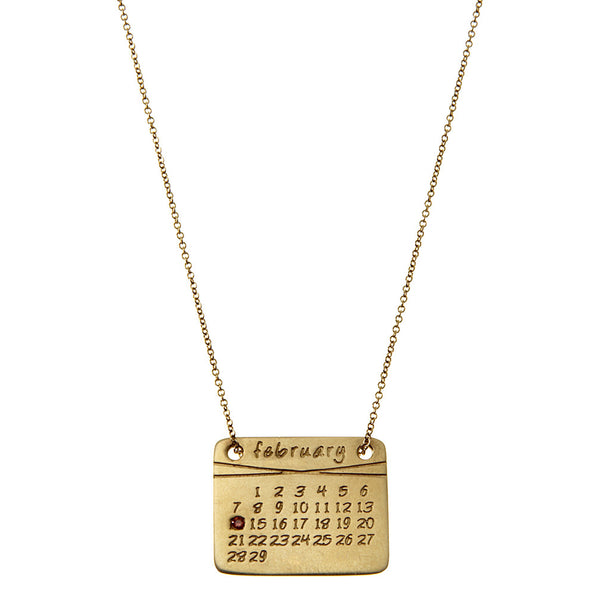 the calendar necklace<sup>®</sup> in yellow or white gold