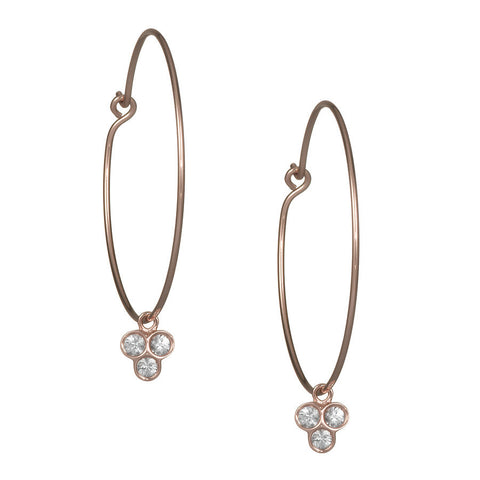 the portafortuna medium hoops in rose gold with white sapphires