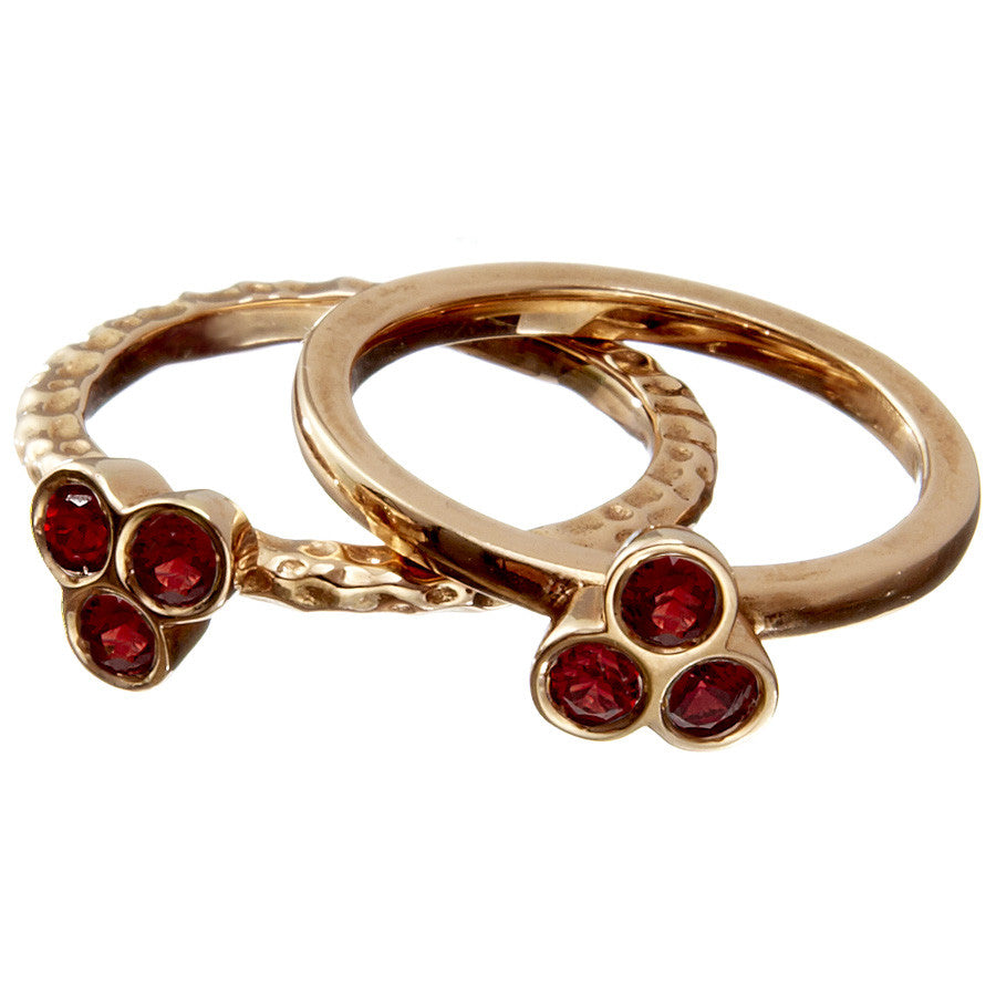 the portafortuna stacking rings in rose gold with red sapphires