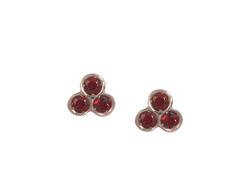 the portafortuna studs in rose gold with red sapphires