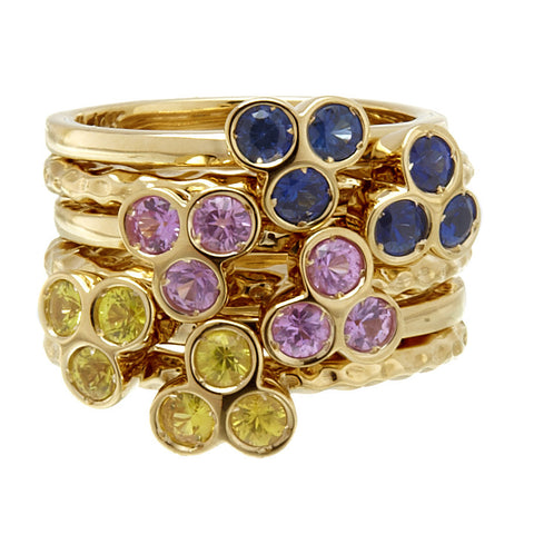 the portafortuna stacking rings in yellow gold with yellow sapphires